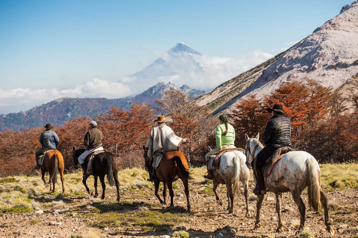 Horse trekking with volcano in the background
